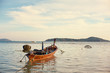 Travel by Thailand. Landscape with traditional longtail fishing boat on the sea surface.