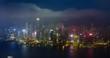 Day to night timelapse of illuminated Hong Kong skyline. Hong Kong, China