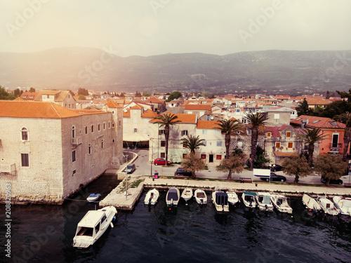 City on the water Aerial shot of the Kastel coast in Dalmatia,Croatia . A famous tourist destination on the Adriatic sea.
