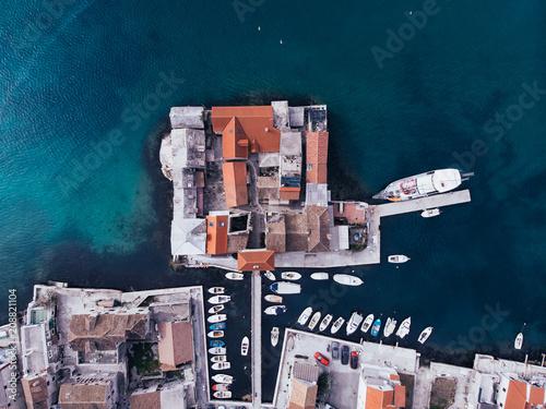 Photo Stands Ship Aerial shot from drone of the Kastel Gomilica, coast in Dalmatia, Croatia. A famous tourist destination on the Adriatic sea.