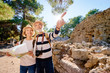 canvas print picture - Family, age, tourism and travel concept. Happy senior couple with map at ancient sightseeing.