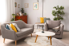Elegant Living Room Interior With Comfortable Sofa And Armchair