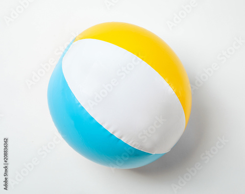 Fotografia  Inflatable ball on white background. Beach object