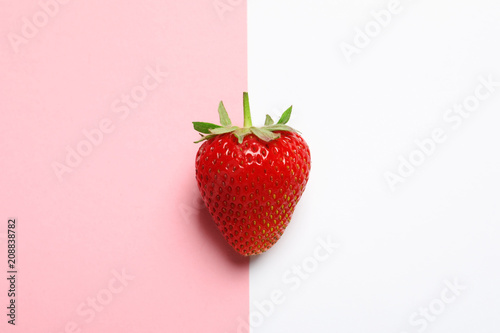 Ripe strawberry on color background, top view