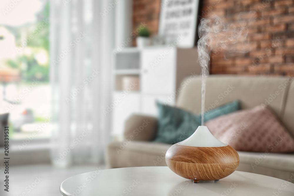 Fototapety, obrazy: Aroma oil diffuser on table at home. Air freshener