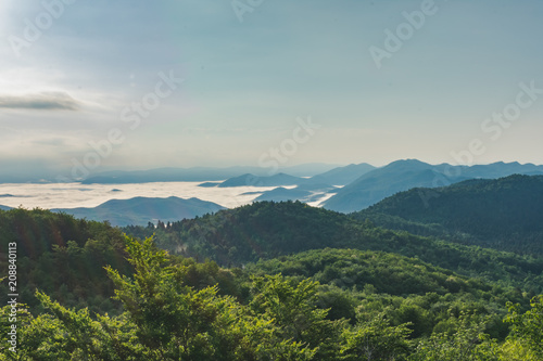 Deurstickers Bleke violet Sunrise over misty forested mountains, Velebit mountain national park in Croatia