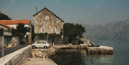 Spoed Foto op Canvas Mediterraans Europa Bay of Kotor,Montenegro.Rustic stone mediterranean housse with old car in front -detail.