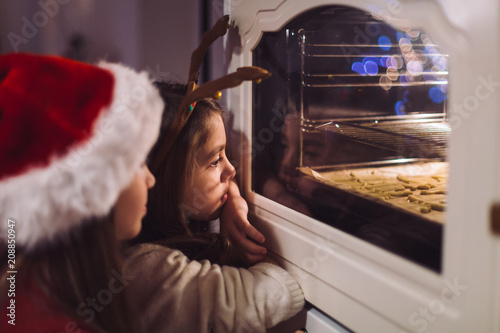 Staande foto Koekjes Girls baking Christmas cookie