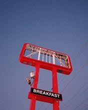 Abandoned Red Marquee With A Breakfast Sign In Front Of A Twilight Sky