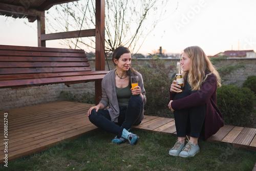 Female friends talking outdoor in the backyard