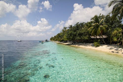 Fotobehang Eiland View of vilamendhoo island at the water bungalows side in the Indian Ocean, Maldives
