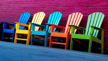 Colorful Chairs Outside By Brick Wall