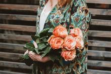 Woman Holding Orange Roses