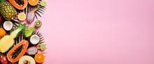 Exotic Fruits And Tropical Palm Leaves On Pastel Pink Background - Papaya, Mango, Pineapple, Banana, Carambola, Dragon Fruit, Kiwi, Lemon, Orange, Melon, Coconut, Lime. Banner. Top View.