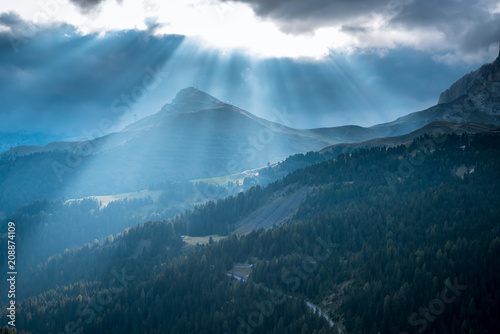 In de dag Blauwe jeans Sunrise silhouettes of Alps mountain and sunlight
