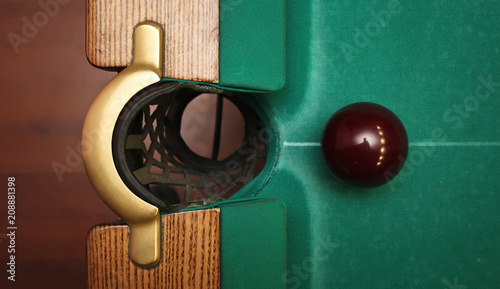 Slika na platnu Closeup shot of red ball going in billiard pocket