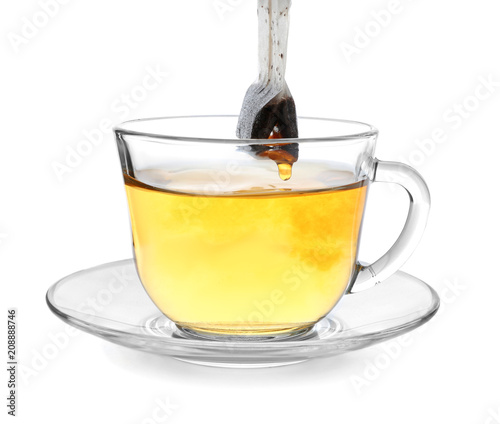 In de dag Thee Brewing of hot beverage with tea bag in glass cup on white background