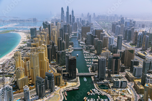 Fotografie, Obraz  Aerial view of modern skyscrapers and sea in the background, Dubai, UAE