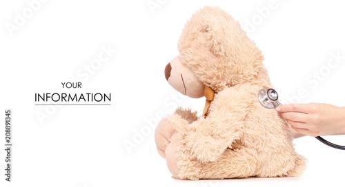 Fotografia  Toy bear stethoscope in hand medical medicine pattern on white background isolat