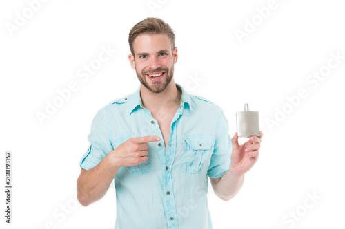 Fotografie, Obraz  Happy man point finger at perfume bottle