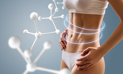 Woman with perfect body near big molecule chain.