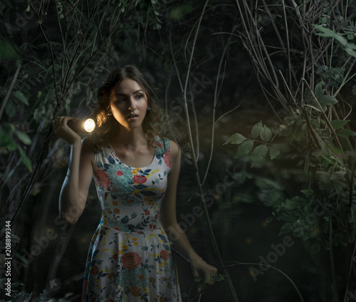 Girl with a lantern at night in a dark forest Canvas Print