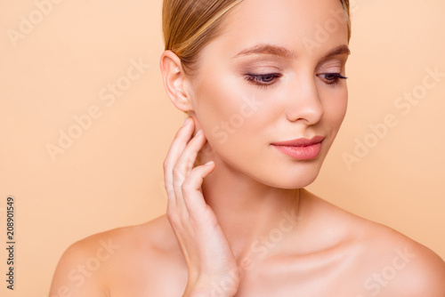 Fototapety, obrazy: Close up cropped portrait of pretty charming girl with perfect ideal face skin after tightening lifting botox injection isolated on beige background. Wellness wellbeing concept
