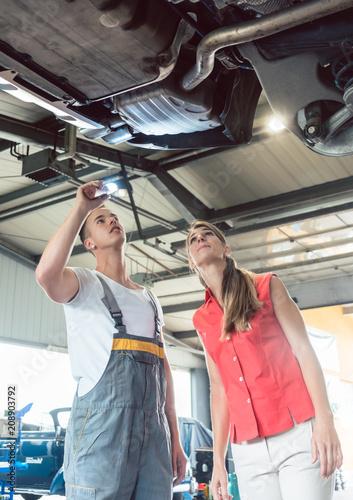 Reliable Auto Mechanics >> Low Angle View Of A Reliable Auto Mechanic Holding A