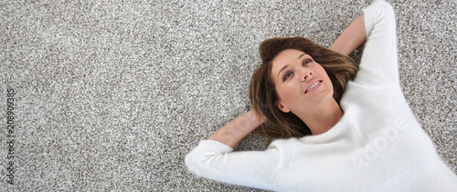 Upper view of woman relaxing on carpet at home, template Fotobehang