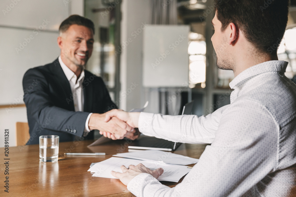 Fotografía  Business, career and placement concept - successful young man smiling, and hands