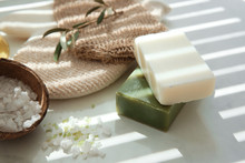 Bars Of Natural Soap With Olive Extract And Sea Salt On Table