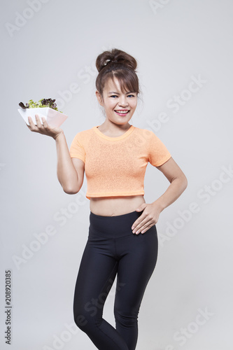 Young Asian Woman holding salad Poster