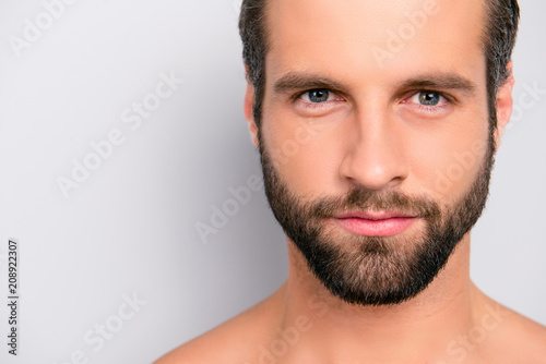 Fotografie, Obraz  Close up cropped portrait with copy space of virile, harsh, manly, attractive, n