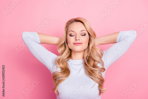 Portrait of cute attractive good girl with modern hairdo natural makeup holding hands behind the head keeping eyes closed dreaming about journey, trip, traveling