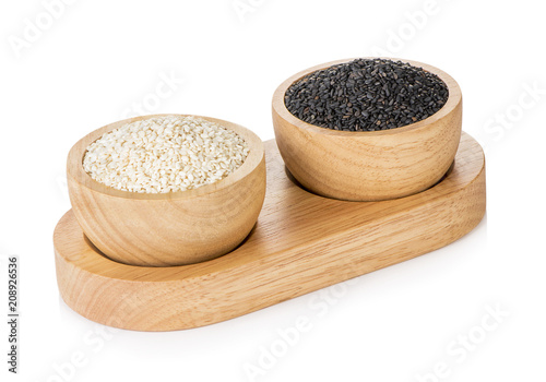 white sesame seeds and poppy seeds isolated in cup on white background