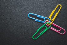Paper Clips On Black Backgroun...