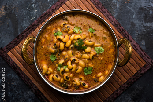 Black Eyed Kidney Beans Curry or Chawli chi usal / Barbati masala, served in a ceramic bowl over moody background, selective focus