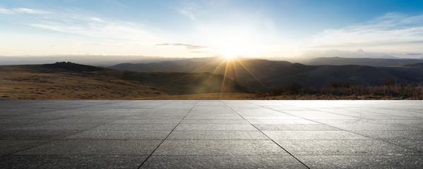 empty brick ground with sunrsise