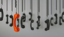 Telephone Receivers Hanging Ov...