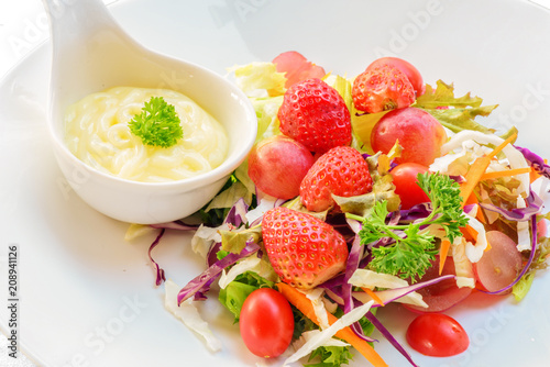 Foto op Aluminium Vruchten closeup of firuits salad and salad dressing in spoon