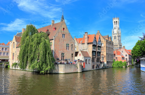 Foto op Plexiglas Brugge The Rozenhoedkaai (canal) in Bruges with the belfry in the background. Belgium, Europe.