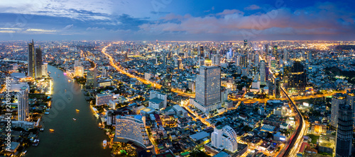 Wall Murals Kiev Aerial view of Bangkok skyline and skyscraper with BTS skytrain Bangkok downtown. Panorama of Sathorn and Silom business district Bangkok Thailand at night.