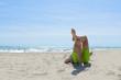 Lazy time. Man lies leg to leg on sea beach on a summer day