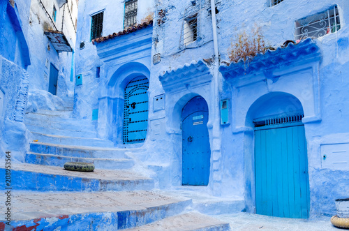 Poster Maroc Street landscape of the of old historical medieval city Сhefchaouen in Morocco. Blue town village narrow streets of medina