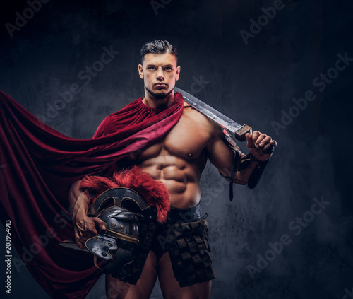 Brutal ancient Greece warrior with a muscular body in battle uniforms Fototapete