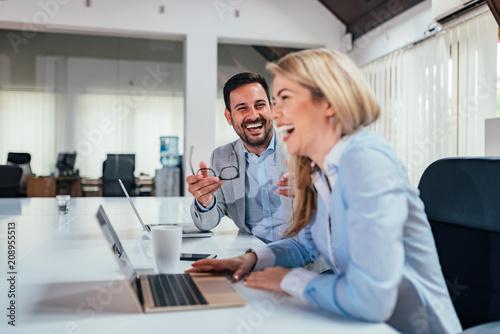 Laughing at work. Fototapeta