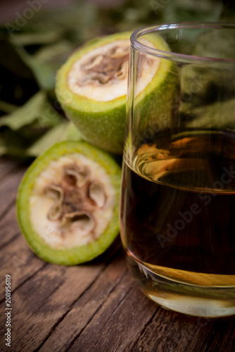 nocino liqueur made with unripe green nuts and alcohol