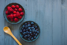 Raspberries And Blueberries On...