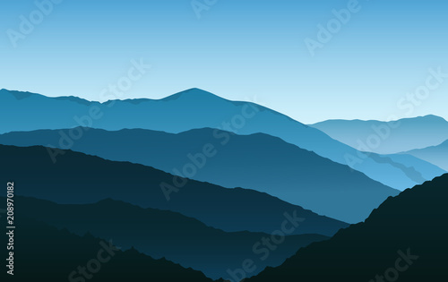 Vector simple blue silhouettes of misty mountains and hills