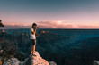 young man takes picture of Magnificent Grand Canyon, Arizona, USA during sunset